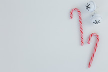 bells and candy canes on white background