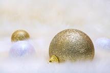 Christmas bulbs on white fluff