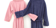 blue and pink snuggling bathrobes