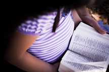 Mother and daughter reading the Bible