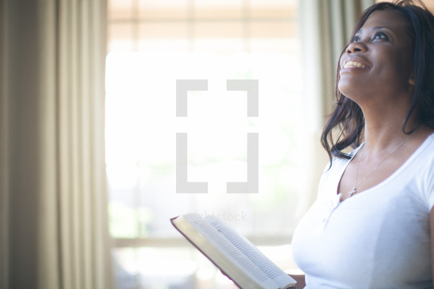 Woman looking up to God in praise