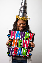 A woman holding a Happy New Year sign