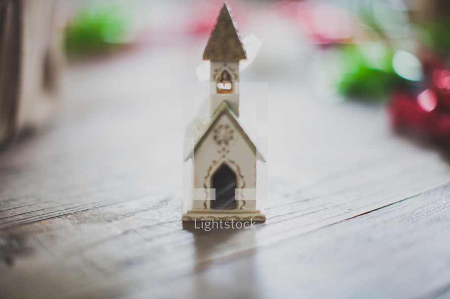 church figurine and Christmas scene