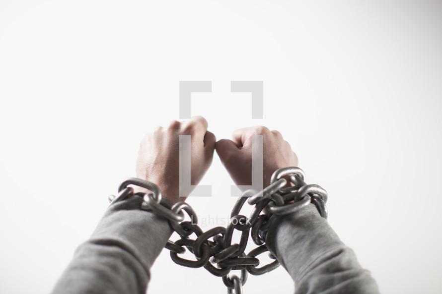 man bound in chains