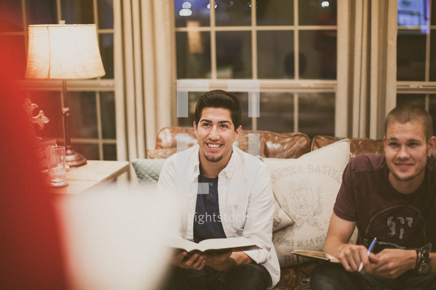 men sitting on a couch at a bible study