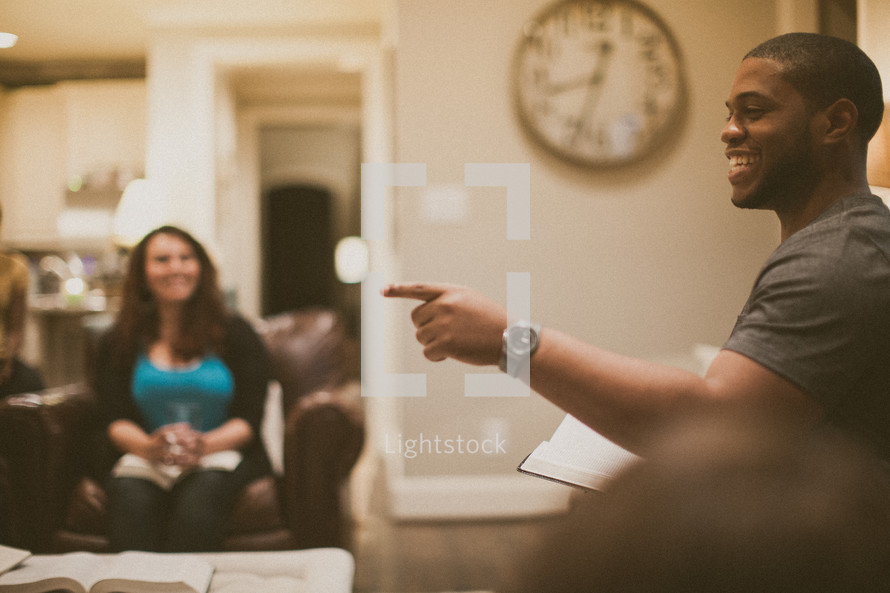 man pointing in a small group Bible study