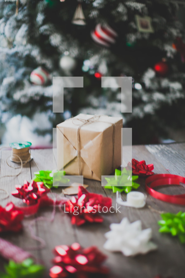 Christmas scene, red, white, green, bows, string, Christmas tree, gift wrappings, decorated, ornaments, brown paper, wrapped gift, gift, present, holidays