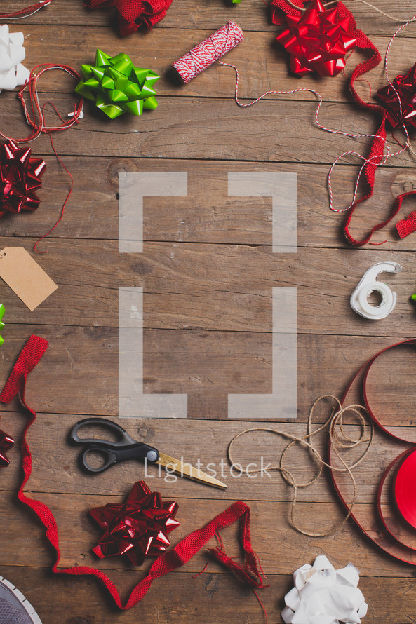 border, Christmas, wood floor, tape, red, green, white, bows, ribbon, string, scissors, gift wrapping