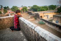 a child looking over a rooftop in India