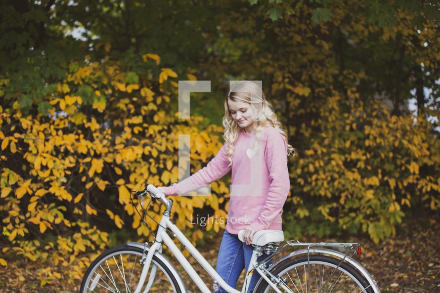 teenage girl with a bike