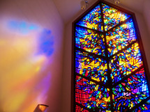 The window to Heaven - a large stained glass window lets light in to fill a prayer chapel with light and warmth as people come in to pray.
