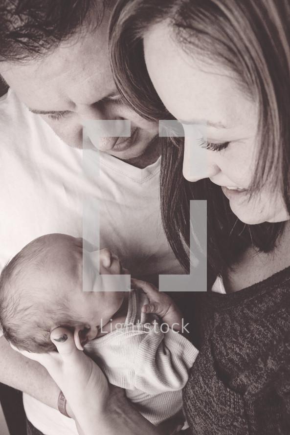 new parents holding a newborn