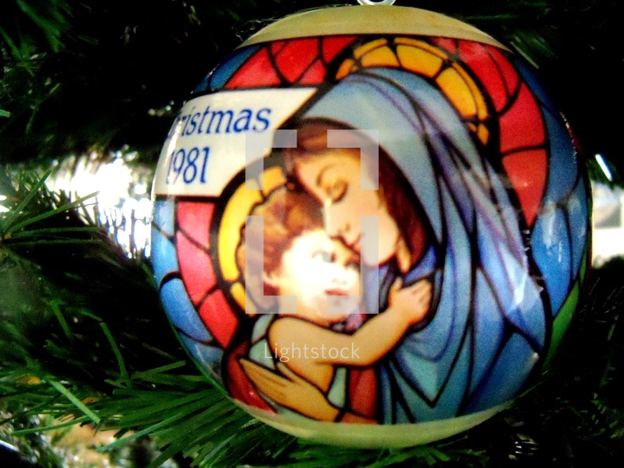 Mary and baby Jesus Christmas ornament decoration on a Christmas Tree at Christmas Time.
