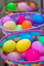 Colorful Easter baskets filled with plastic Easter eggs.