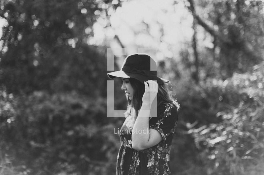 teen girl in a hat standing outdoors