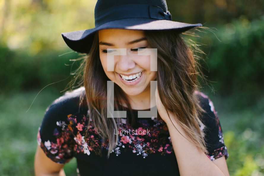 a teen girl in a hat