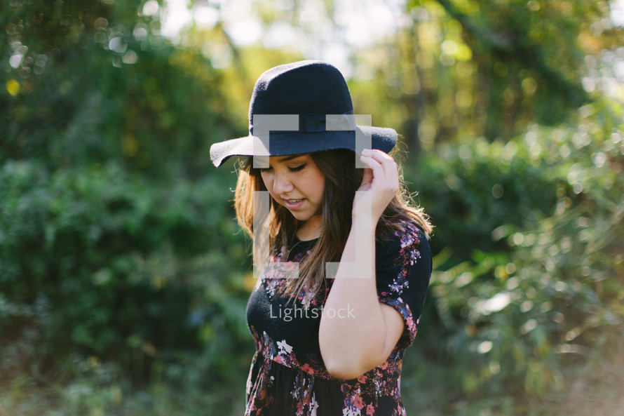 portrait of a teen girl in a hat