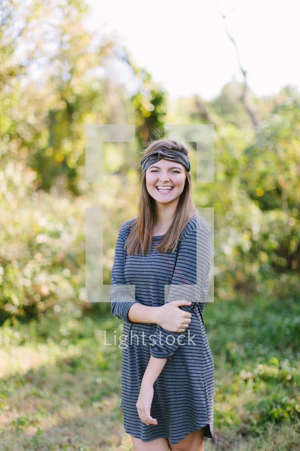 portrait of a teen girl standing outdoors