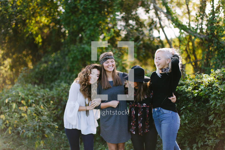 portrait of female friends standing together outdoors