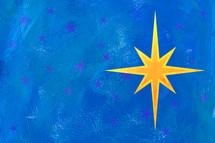 Christmas star on blue