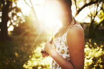 sunburst over a woman's face