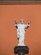statue of Jesus with hands raised
