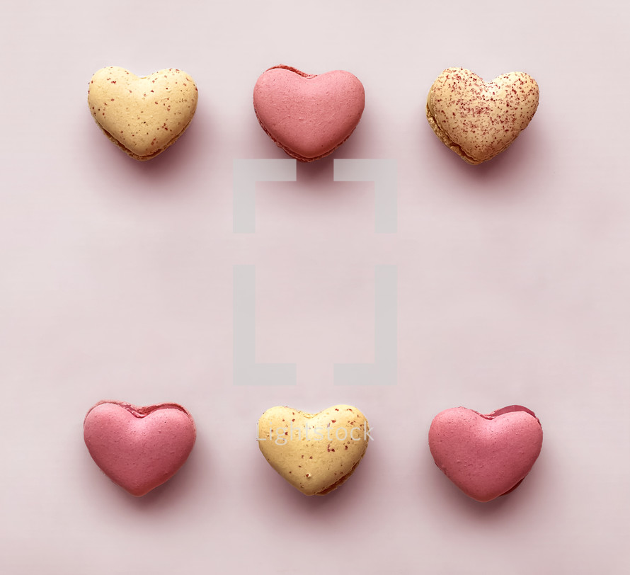 macaron cookies on a pink background for Valentine's Day