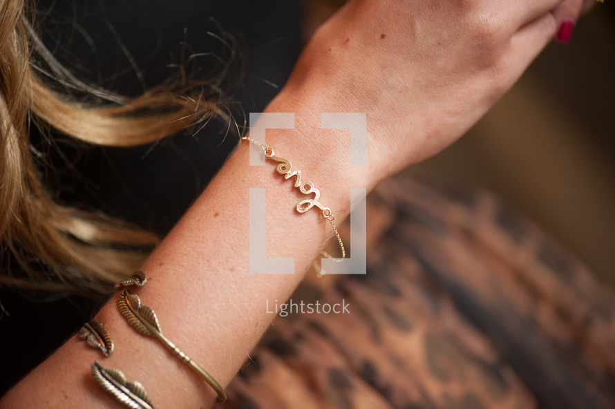 Woman's arm with bracelets.
