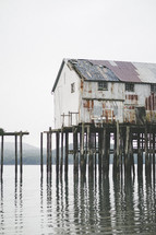 buildings on stilts along a shore in Alaska