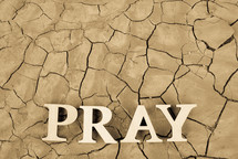 word pray on parched soil