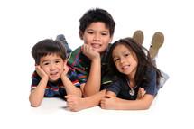 Siblings posing on the floor.