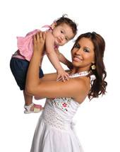 woman holding a baby girl over her head