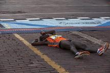 marathon runner on the ground