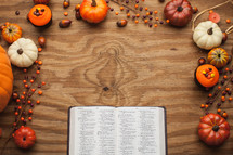 open Bible surrounded by fall themed decorations