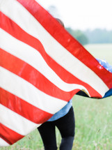 woman running with an American flag
