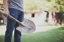 man holding a shovel