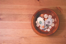 money folded into a heart in the offering plate