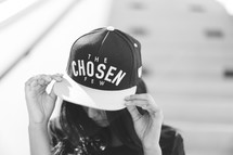 woman wearing a ball cap with the words the chosen few