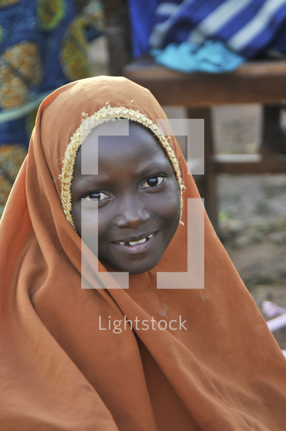 Sundanese Muslim shrouded girl smiling