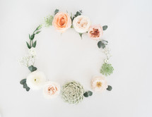 wreath of flowers on white background