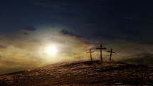 Three crosses on a hill at dusk with moving clouds background. Easter and Good Friday concept. Seamless looping