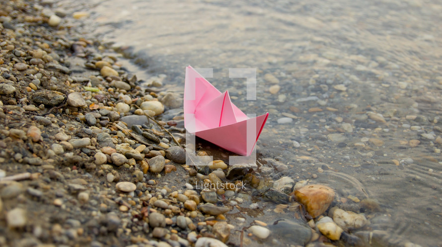 paper boat on a shore