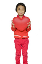 a child holding a heart