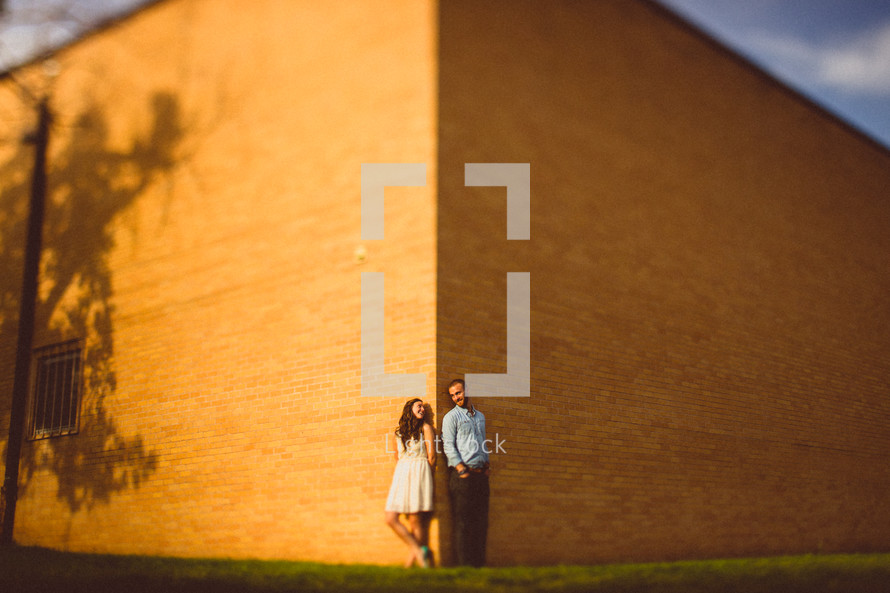 Couple standing in front of building
