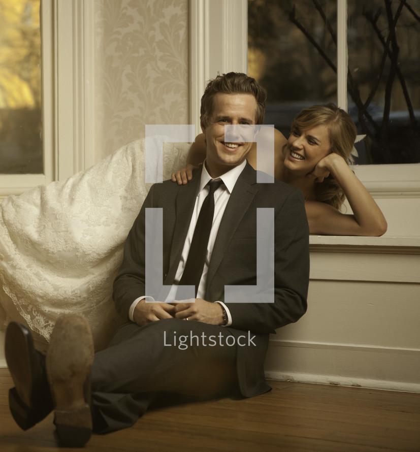 bride lying behind her groom