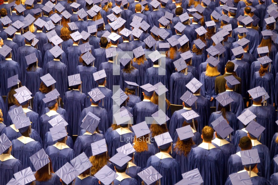 A crowd of graduates in cap and gown