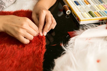 seamstress sewing a fox costume