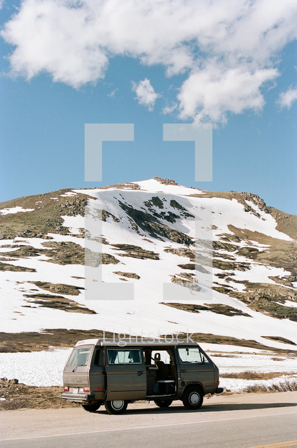 van parked by a snow covered hill