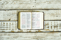 open Bible on weathered wood boards