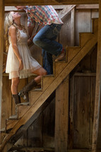 Happy couple on staircase steps